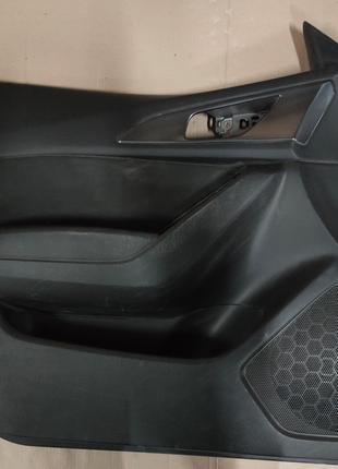 Обшивка двери Mazda 3