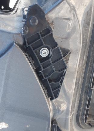 Крепление задн бампера левое средн Toyota Corolla 150 52158-12090