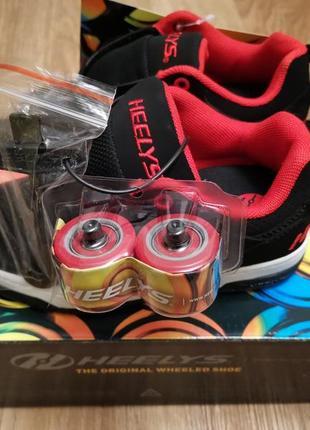 Роликовые кроссовки heelys unisex kids' voyager tennis shoe ор...
