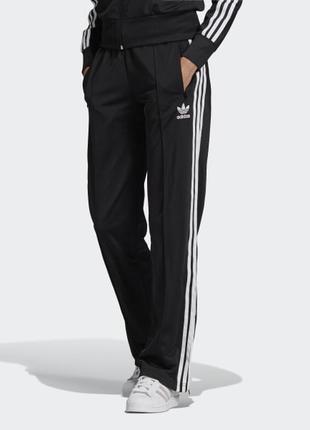 Черные женские теплые спортивные штаны брюки лампасами полоска...