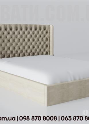 Кровать двуспальная с мягким изголовьем.