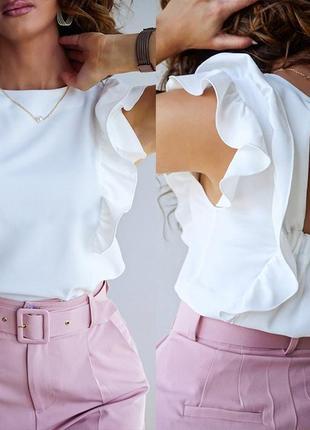 Женская блузка с рюшами и бантом