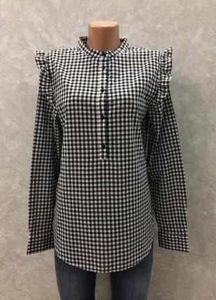 Блуза в клетку с рюшами