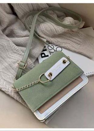 Женская сумка-клатч зеленого цвета