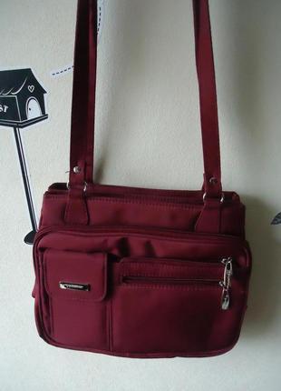 Очень вместительная модная сумка цвета бургунди с кучей карманов