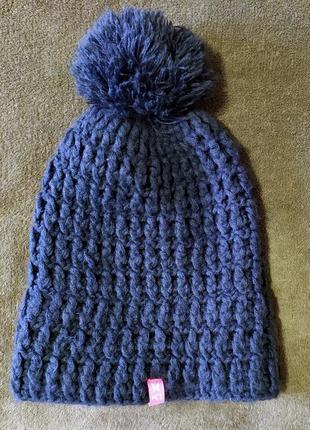 Вязанная с утеплением на ушах шапка kari traa пог 25-30см