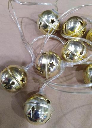 Led гирлянда с металлическими золотистыми бубенчиками со звезд...