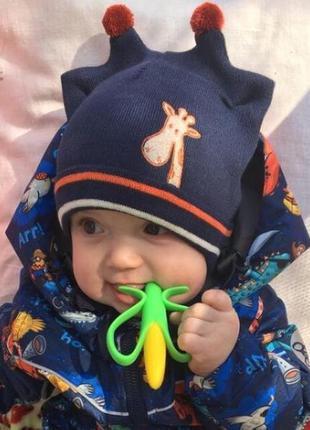 Тонкая демисезонная шапка с завязками для мальчика от 1 года 4...