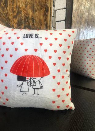 Подушка love is ... отличный подарок на день влюбленных .