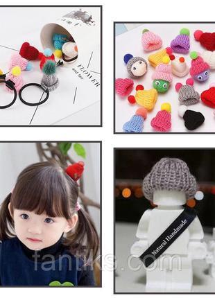 Набір маленьких в'язаних шапочок - 5 штук