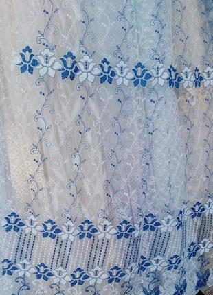 Тюль с синей вышивкой на микросетке.