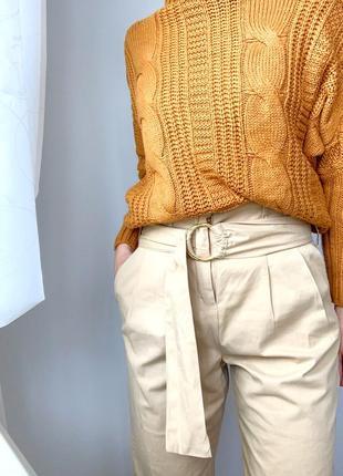 Бежеві штани з поясом кольцом
