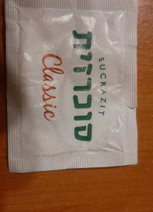 Пакетик с сахаром.