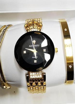 Популярные женские часы baosaili ( баосаили) золото-черные