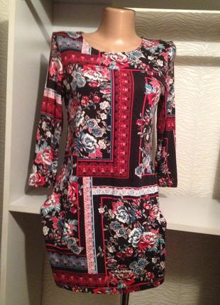 Коротенькое трикотажное платье.045