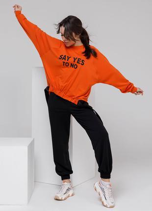 Черно-оранжевый свободный костюм из трикотажа городского стиля