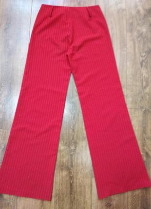 Красные в белую полоску штаны клеш на высокий рост.