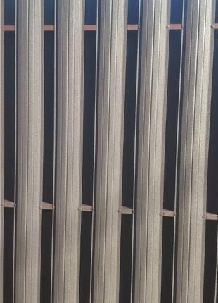 Двухсторонний матовый евроштакет коричневого цвета Ral 8019 цена