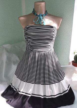 Изумительное платье-бюстье  в черно-белую полоску с карманами,...
