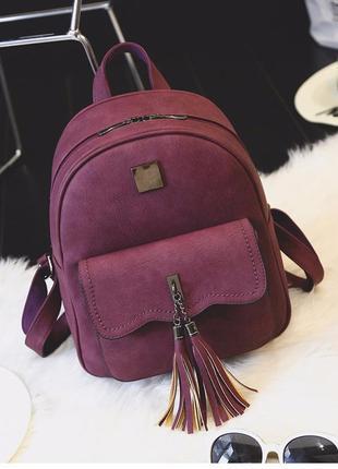 Рюкзак женский матовый с кисточками и карманом цвета марсала (...