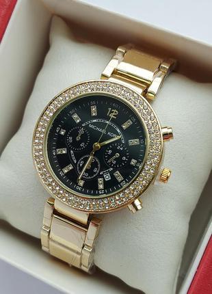 Женские наручные часы золотого цвета с черным циферблатом, два...