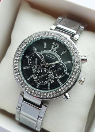 Женские серебристые часы с черным циферблатом, камушки на метк...