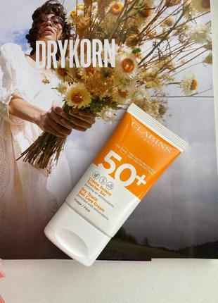 Солнцезащитный крем для лица clarins sun care dry touch face c...