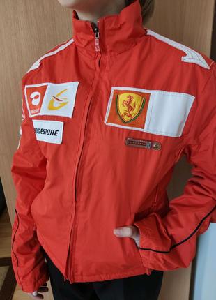 Спортивна куртка для дівчинки , на ріст 165 , стан нової, Італія.