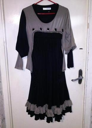 Чудесное,трикотаж-стрейч-платье с воланами,люверсами и оригин....