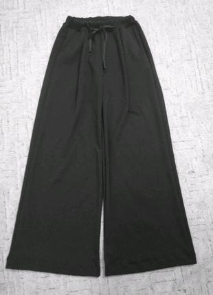 Трендовые широкие длинные в пол брюки палаццо и кюлоты из трикота