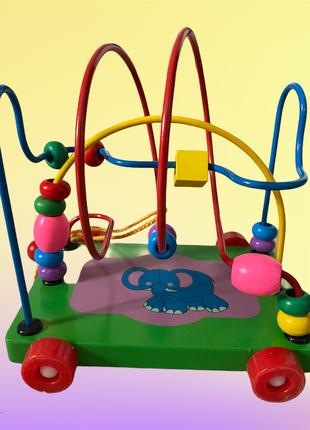 Деревянная игрушка-каталка очень полезна