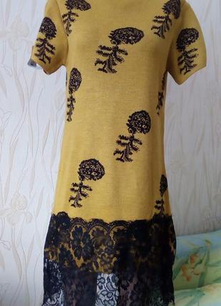 Стильное платье,декорированное кружевом favorito(италия)