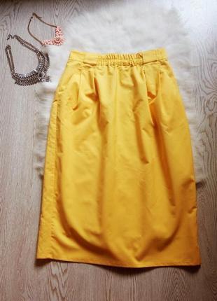 Яркая желтая юбка миди с карманами вырезом длинная пышная цвет...