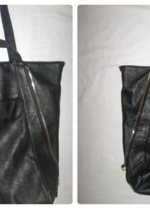 Трендовая вместительная сумка с плотного кожзама,по бокам замочки