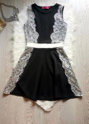 Нарядное черное платье с белыми ажурными вставками гипюра и юб...