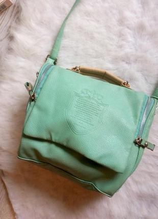 Маленькая вместительная бирюзовая мятная сумка с молниями по б...