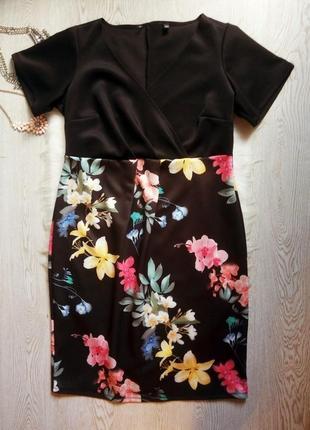Черное нарядное длинное миди платье с вырезом декольте на запа...