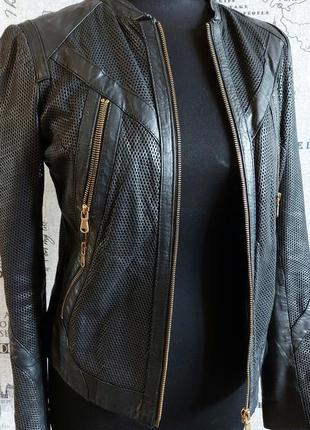 Крутая кожаная куртка с перфорацией