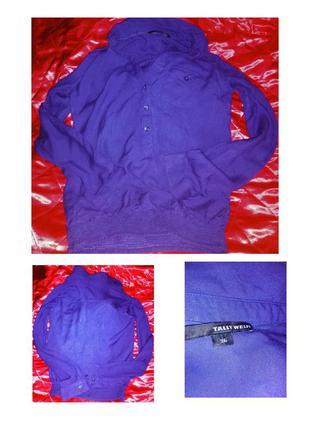 Рубашка из вискозы фиолетового цвета.
