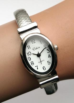 Eikon часы из сша в виде не замкнутого браслета мех. singapore...