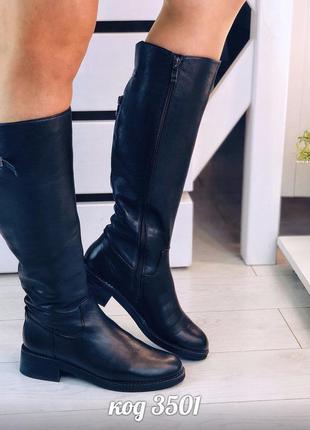 Чорні шкіряні чоботи