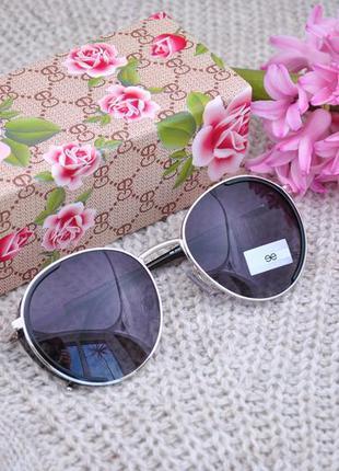 Фирменные солнцезащитные круглые очки с боковой защитой eterna...