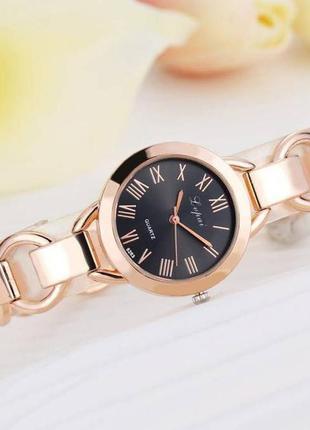 Часы на руку золотые стильные женские