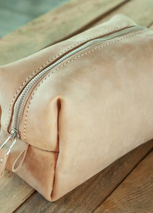 Дорожная сумка для косметики из кожи.