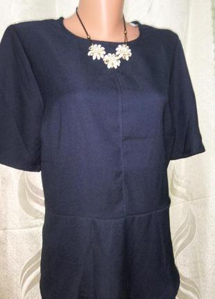 Широкая блузка с баской