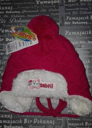 Теплая зимняя шапка для девочки