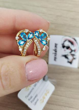 Позолоченные серьги с голубыми камнями