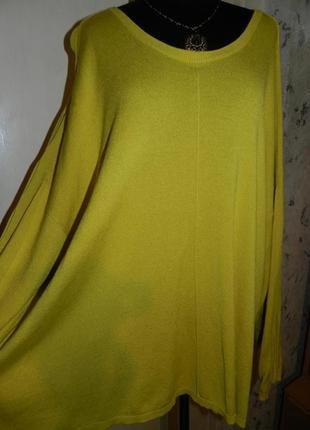 Эффектная,трикотажная блузка-джемпер с прорезями на...