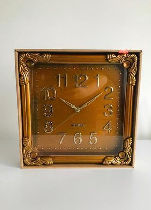 Часы, настенные часы, новые часы, золотисто-коричневые часы.