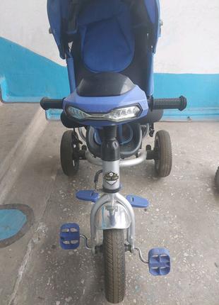 Продам детский трехколесный велосипед с родительской ручкой